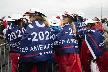 People wait in line to attend a campaign rally with President Donald Trump in Hershey, Pa., Tuesday, Dec. 10, 2019. (AP Photo/Matt Rourke)