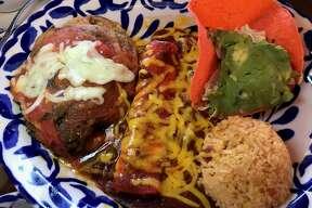 A picadillo-stuffed chile relleno and cheese enchilada at Mi Familia de Mi Tierra
