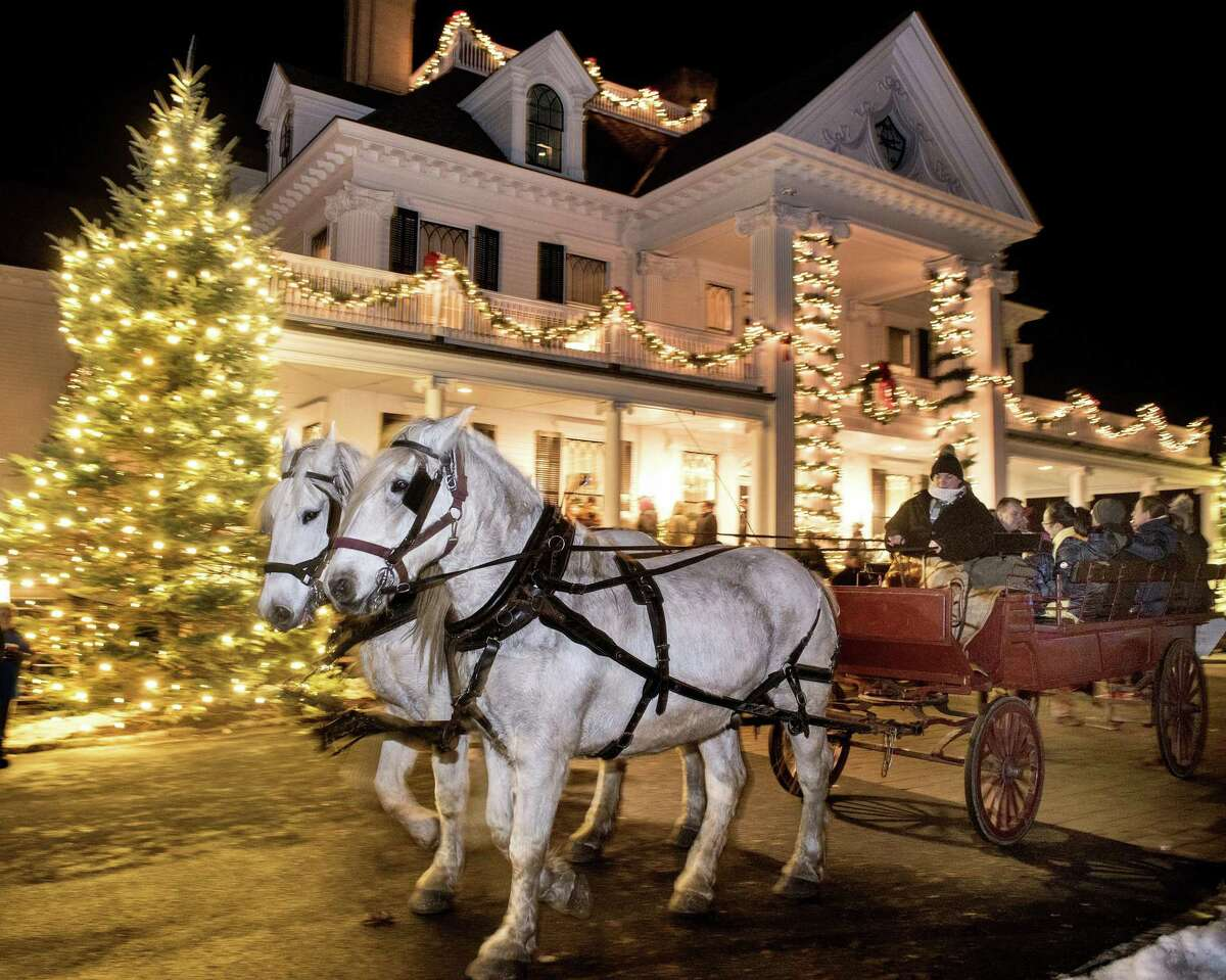 Visitors to the Ridgefield Holiday Stroll rode horse-drawn carriages on Friday, Dec. 6, 2019 in Ridgefield, Conn. Visitors to the Ridgefield Holiday Stroll rode horse-drawn carriages on Friday, Dec. 6, 2019. A four-weekend series of events designed to spread out the crowds amid the COVID-19 pandemic has now been canceled.