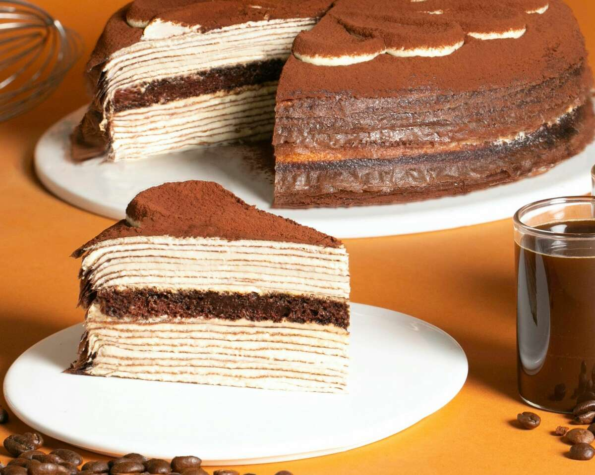New York City'sLady M Confections is bringing its renowned crepes cakes back to Houston. Each decadent dessert features no less than 20 paper-thin crepes and fluffy pastry cream. Pictured: The tiramisu crepe cake at Lady M.