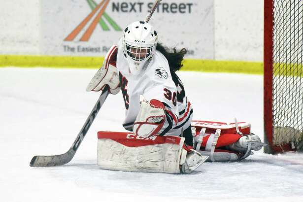 New Canaan goalie Blythe Novick makes a glove save during the CHSGHA State semifinals at The Rinks at Shelton on Wednesday, March 6.