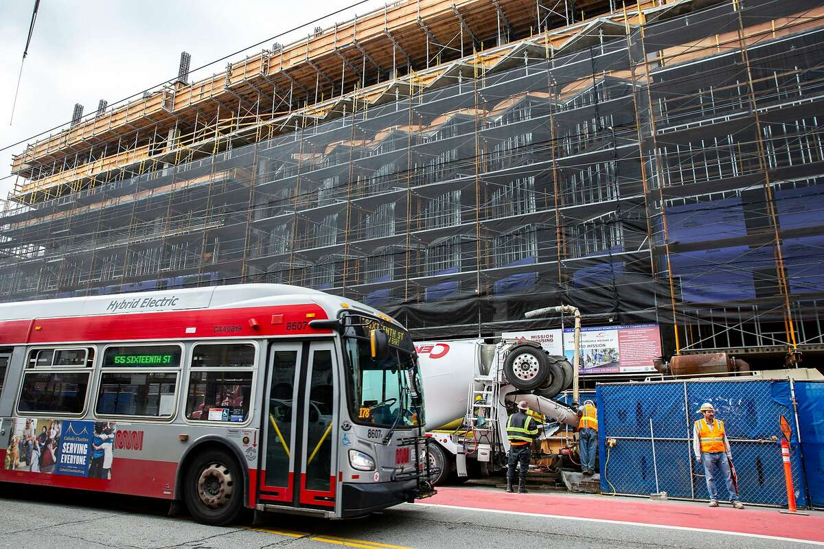 The 55-Sixteenth Street bus drives past the construction site at 950 Mission Street on Tuesday, Dec. 10, 2019, in San Francisco, Calif.