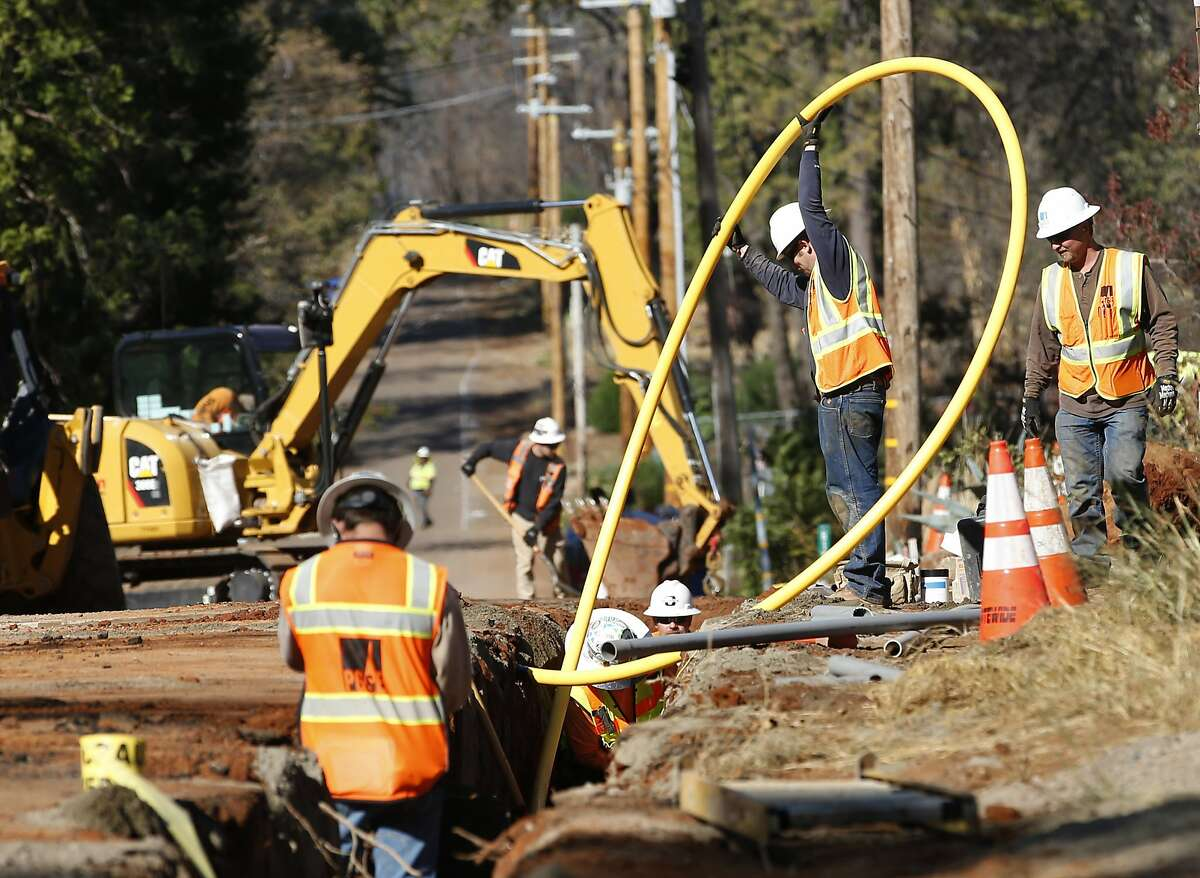 PG&E workers bury lines in Paradise. A firm contracted by state utility regulators analyzed PG&E's controversial fire shut-offs from 2019.