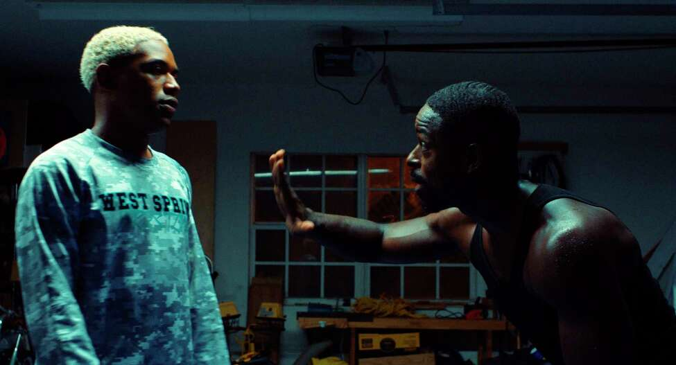 """This image released by A24 shows Kelvin Harrison Jr., left, and Sterling K. Brown in a scene from """"Waves."""" (A24 via AP)"""