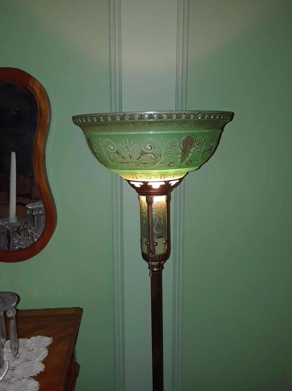 The Hotchkiss-Fyler House, home of the Torrington Historical Society at 192 Main St., is open for holiday tours starting Dec. 12. Above, an antique lamp on the second floor.