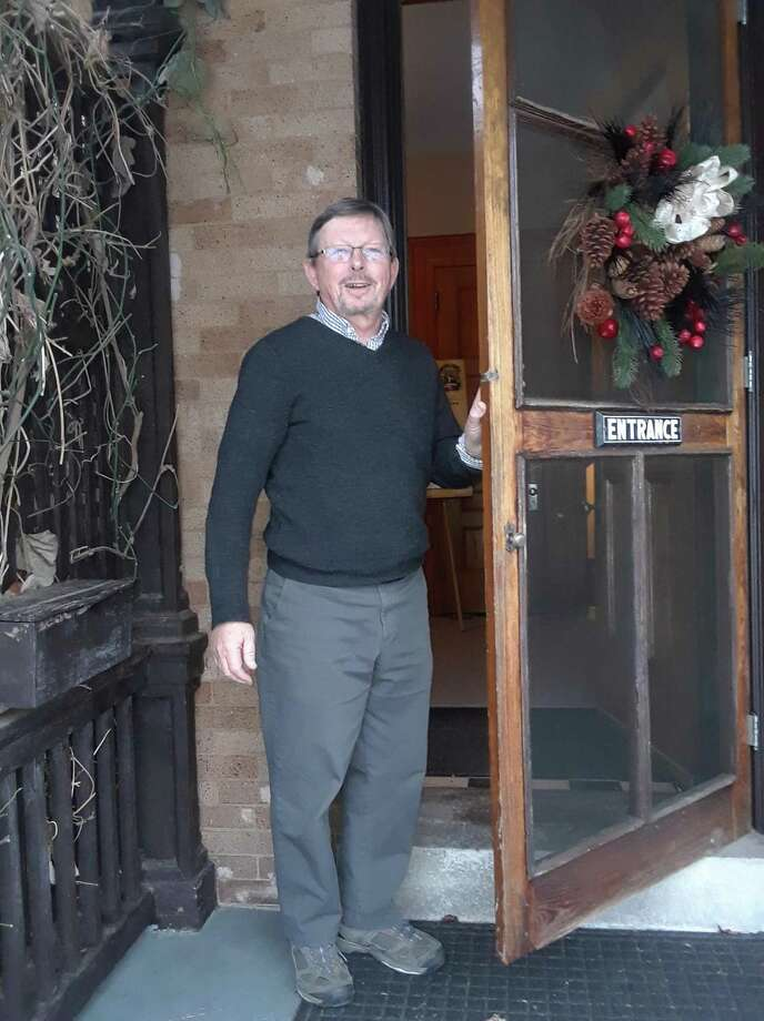 "Torrington Historical Society executive director Mark McEachern, shown here greeting guests for tours, is asking residents to contribute their coronavirus pandemic experiences and photos for ""Torrington Together 2020,"" a digital archive. Photo: Emily M. Olson / Hearst Connecticut Media /"