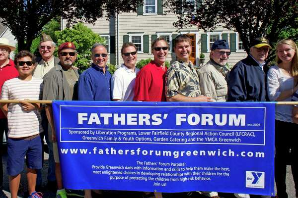 Past Father's Forum participants pose for a photo at an event in 2013.
