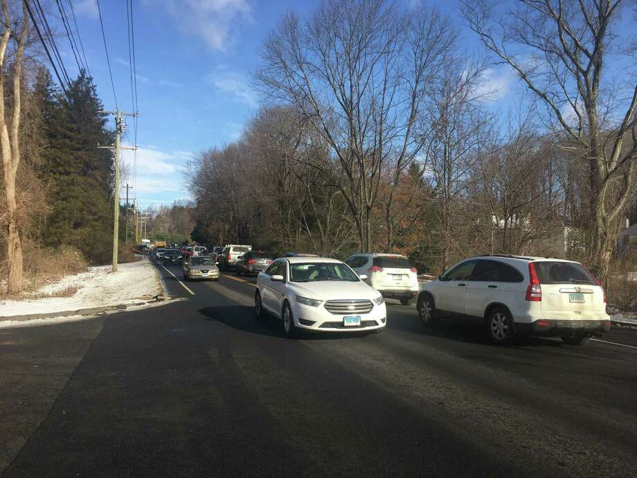Traffic backs up near the exit of the Ridgefield Recreation Center on 195 Danbury Road on Thursday, Dec. 5. Photo: Stephen Coulter / Hearst