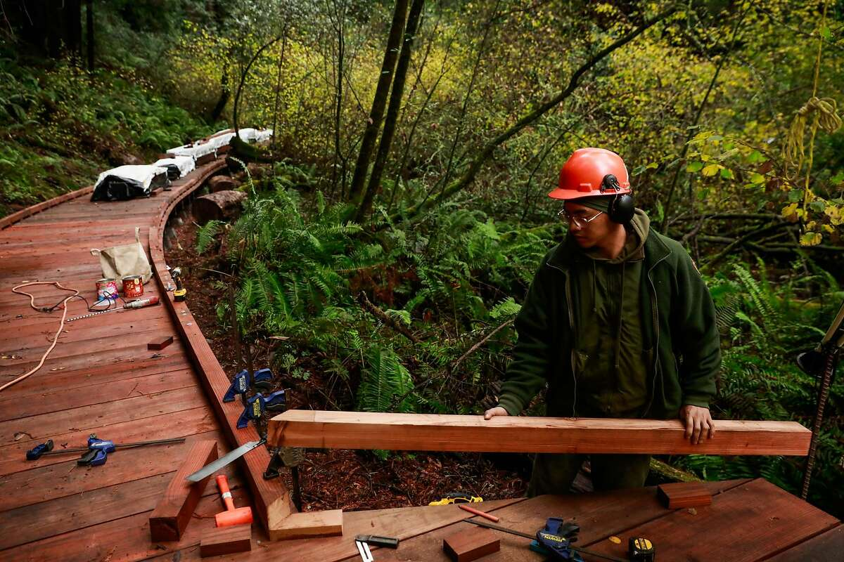 Trail crew member Adriel Asuncion builds a new path alongside the Bohemian Grove trail during renovations at Muir Woods in Mill Valley, California, on Monday, Dec. 9, 2019.