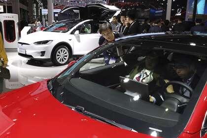 China's electric car sales slump, squeezing auto makers