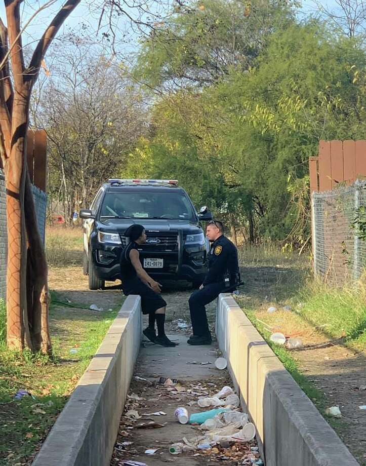 "An SAPD moment between an officer and a ""troublemaker"" is drawing attention by the thousands online. The original photo posted by Marqué Danielle Scahill showing her partner, later identified as Officer Vallejo, sitting down and speaking with a man in an alley has racked up more than 30,000 shares and 5,000 comments since she posted the picture on Sunday. Photo: Marqué Danielle Scahill/SAPD"