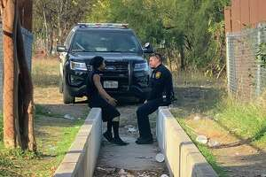 "An SAPD moment between an officer and a ""troublemaker"" is drawing attention by the thousands online. The original photo posted by Marqué Danielle Scahill showing her partner, later identified as Officer Vallejo, sitting down and speaking with a man in an alley has racked up more than 30,000 shares and 5,000 comments since she posted the picture on Sunday."