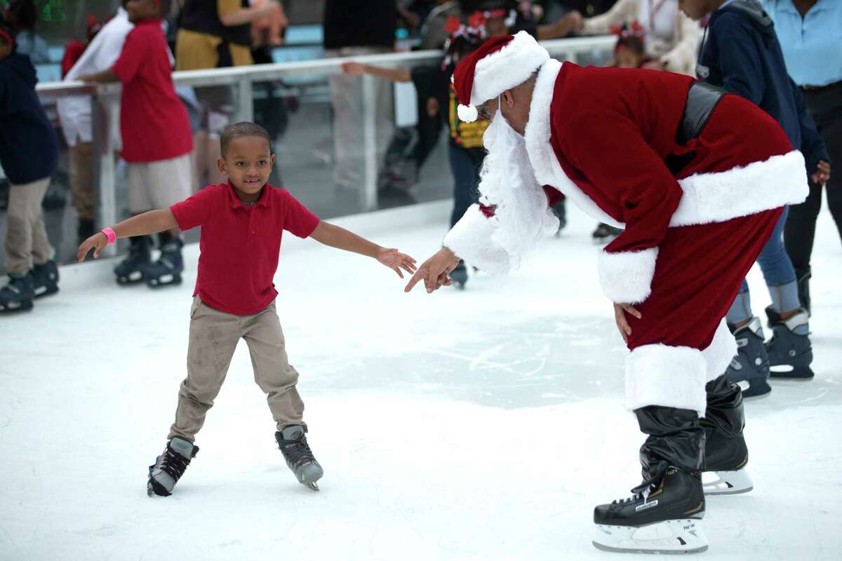 Hundreds of children from the Third Ward area enjoy some holiday fun at the 4th Annual Year of Joy Holiday Skating Party at Discovery Green on Monday, Dec. 9, 2019.