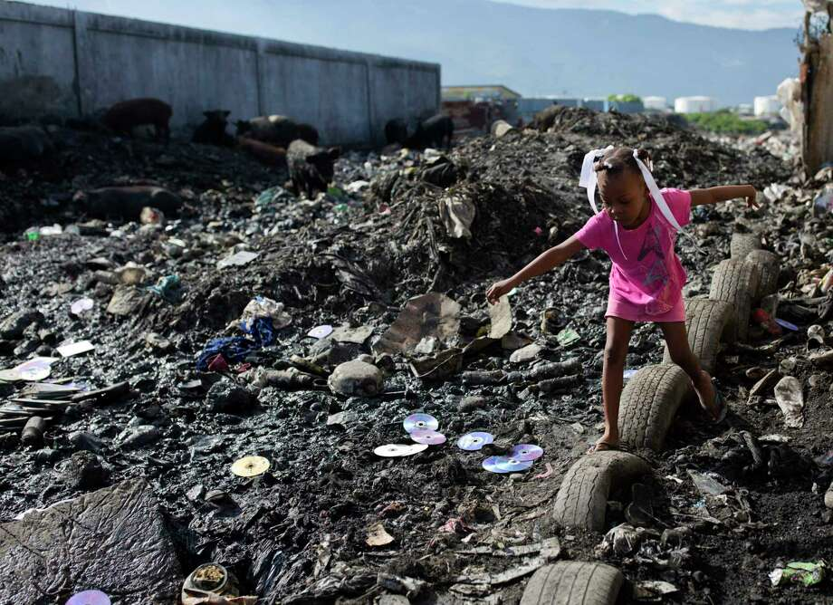 Yes, 2019 brought its share of worrisome news. But things have never been better in human history. Global poverty is declining. Literacy is increasing. Each day, people get their first access to electricity. In this 2017 photo, a girl navigates a slum in Haiti. Photo: Dieu Nalio Chery /Associated Press / Copyright 2018 The Associated Press. All rights reserved.
