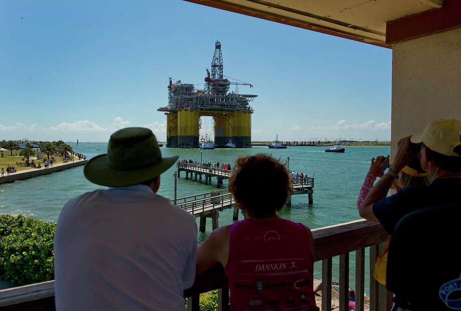 People gather to watch the Royal Dutch Shell Plc Olympus tension leg platform set sail in Port Aransas in 2013. . A reader is concerned a potential oil terminal on Harbor Island is going to damage Port Aransas' environment. Photo: Bloomberg File Photo / © 2013 Bloomberg Finance LP