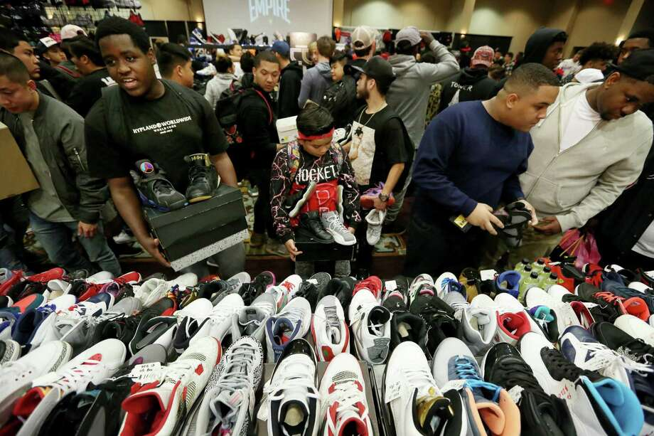 Sneaker lovers gather at a Nike Air Jordans booth to trade or buy sneakers at H-Town Sneaker Summit Sunday, Dec. 4, 2016, in Houston. ( Yi-Chin Lee / Houston Chronicle ) Photo: Yi-Chin Lee, Staff / Houston Chronicle / © 2016  Houston Chronicle