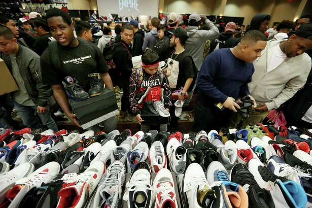 Sneaker lovers gather at a Nike Air Jordans booth to trade or buy sneakers at H-Town Sneaker Summit Sunday, Dec. 4, 2016, in Houston. ( Yi-Chin Lee / Houston Chronicle )