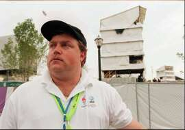 FILE- In this July 28, 1996, file photo, security guard Richard Jewell poses  across from the tower where he found a bomb and warned visitors at Centennial Olympic Park in Atlanta. When a bomb exploded in a downtown Atlanta park midway through the 1996 Olympics, it set news reporters and law enforcement on a collision course that upended the life of a security guard, turning him from hero to villain overnight. Now, more than 20 years later, a recent book and upcoming movie explore Jewell's ordeal and the roles played by law enforcement and the media. (William Berry/Atlanta Journal-Constitution via AP, File)