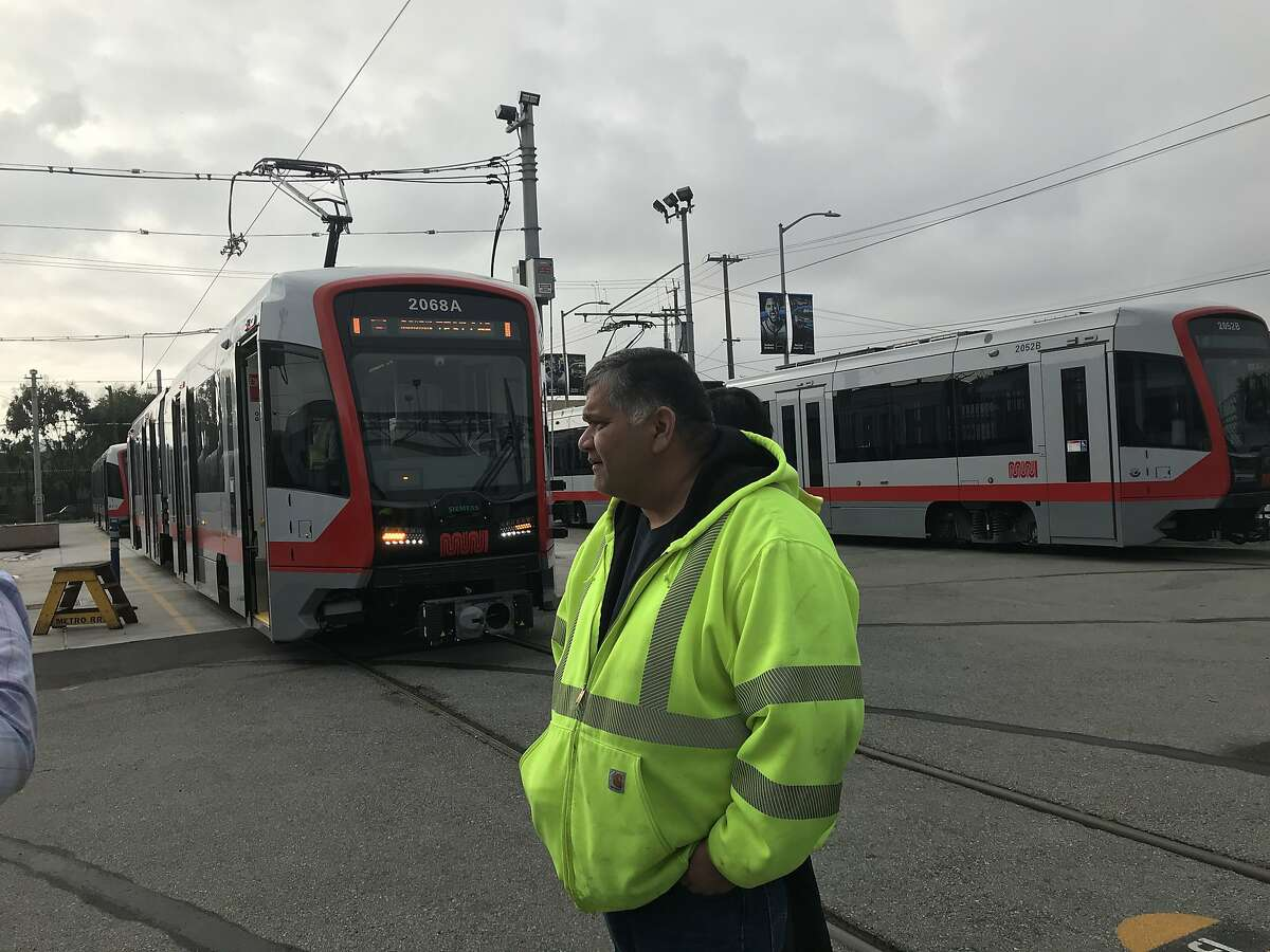 Test supervisor Emmanuel Enriquez stands in front of Car No. 2068, the last vehicle in Muni's first rollout of new trains.
