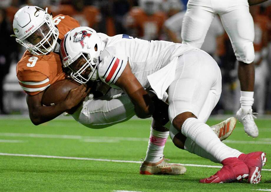 Dobie quarterback Cameron Gray, left, is sacked by Atascocita defensive lineman Asyrus Simon during the first half of a high school football game, Friday, Oct. 18, 2019, in Pasadena, TX. Photo: Eric Christian Smith / Contributor / Houston Chronicle