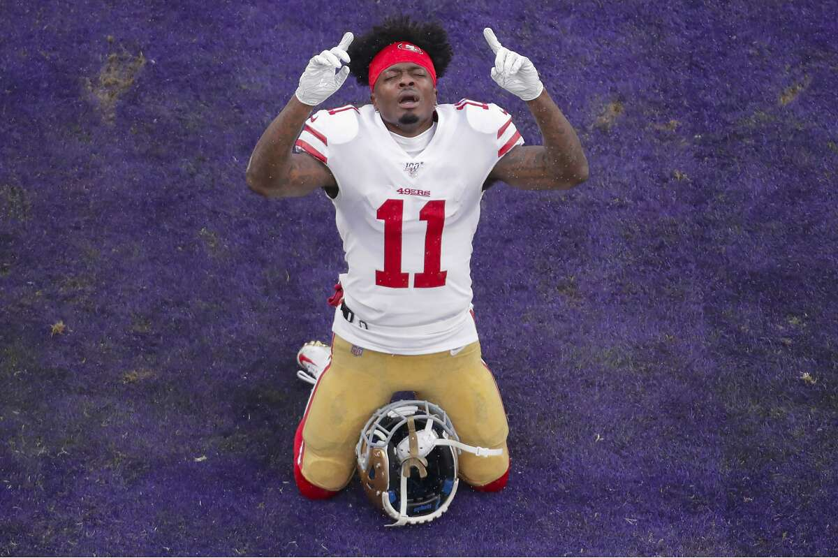 San Francisco 49ers wide receiver Marquise Goodwin (11) kneels on end zone before the start of an NFL football game against the Baltimore Ravens, Sunday, Dec. 1, 2019, in Baltimore, Md. (AP Photo/Julio Cortez)