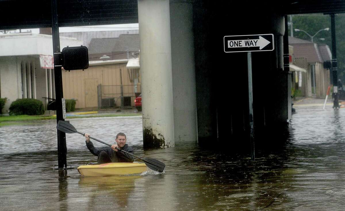 A man kayaks up Calder Avenue in Beaumont where several roads remained heavily flooded throughout the afternoon. Boaters and other emergency personnel were conducting rescue missions to those in need throughout the morning and afternoon. Photo taken Thursday, September 19, 2019 Kim Brent/The Enterprise