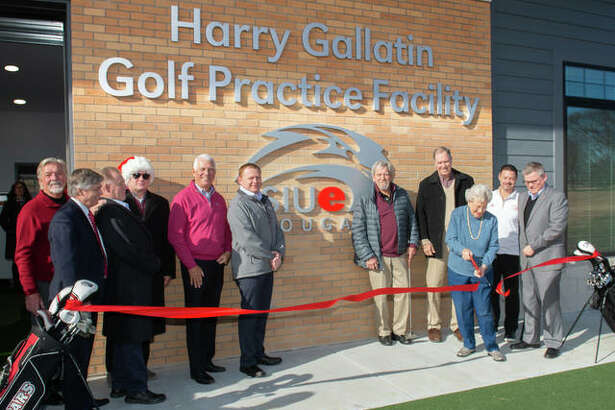 Bev Gallatin cuts the ribbon at the dedication of the new Harry Gallatin SIUE Golf Practice Facility at Sunset Hills Country Club in Edwardsville.