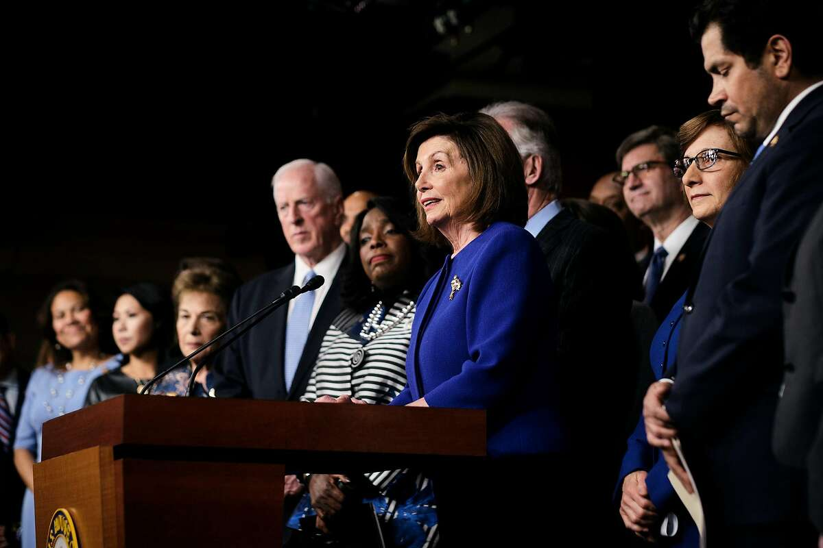 House Speaker Rep. Nancy Pelosi (D-Calif.) and other members of the House announce the completion of the USMCA trade agreement, on Capitol Hill in Washington, Tuesday, Dec. 10, 2019. The decision to proceed with the United States-Mexico-Canada-Agreement came after Democrats said they secured concessions from the White House to strengthen provisions in a trade pact that governs commerce across North America. (T.J. Kirkpatrick/The New York Times)
