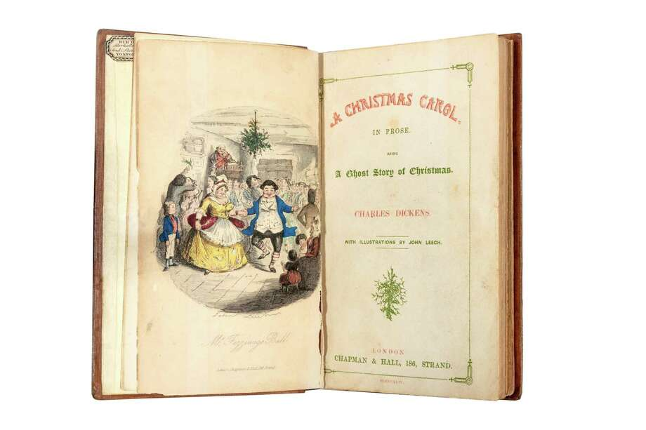 "Pictured is the first edition of the book titled, ""A Christmas Carol,"" by author Charles Dickens. Photo: Lewis_Bush / Charles Dickens Museum / www.lewisbush.com"