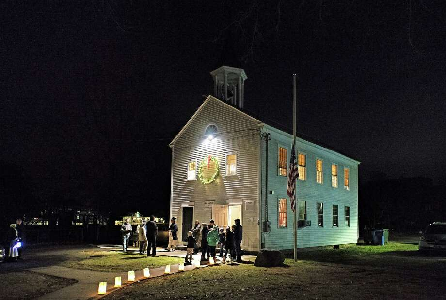 The Madison Historical Society's Holiday Lantern Light Tour offers visitors a 90-minute journey through time to glimpse a period in Madison's history. Photo: Bob Gundersen / Contributed Photo / ALL RIGHTS RESERVED
