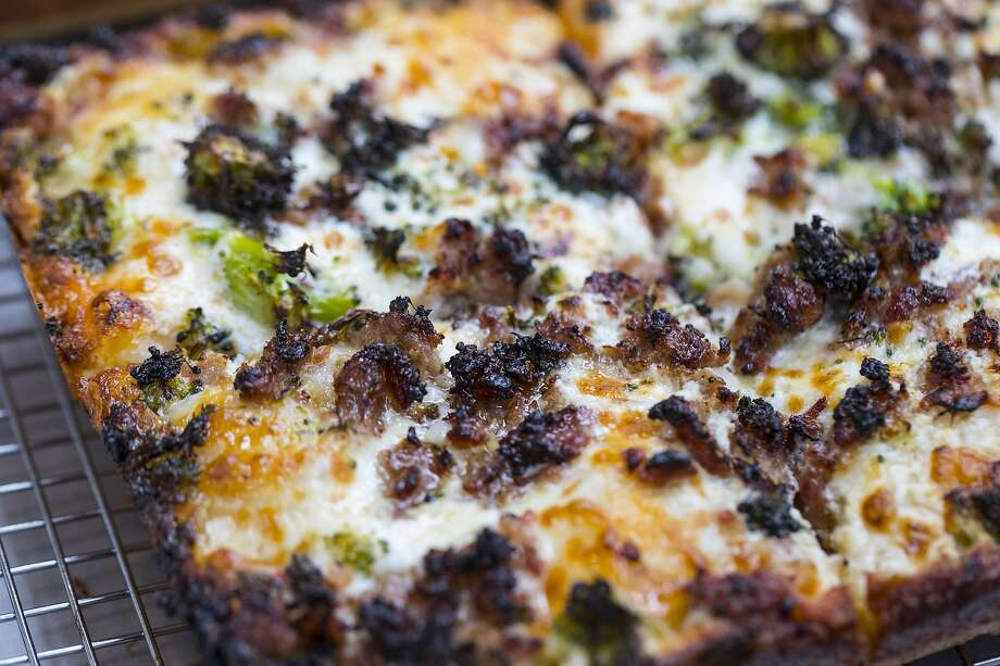 The mean green sausage machine is a deep dish pizza at Square Pie Guys in San Francisco, Calif. Square Pie Guys is a new Detroit-style pizza shop in SoMa owned by Marc Schechter and Danny Stoller. Photo: Brian Feulner, Special To The Chronicle