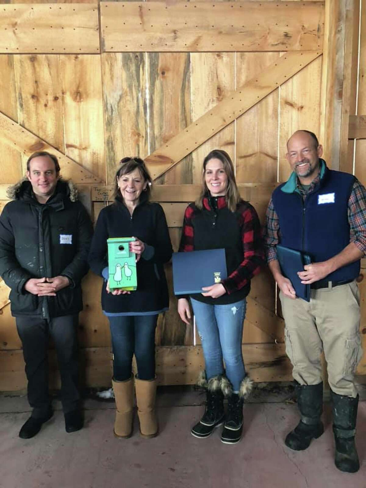 The Barber Family of Northumberland, Benj Gleeksman, Linda and Amber Barber, pose with Saratoga PLAN Chair Will Orthwein at the PLAN's celebration of Conservation Heroes.