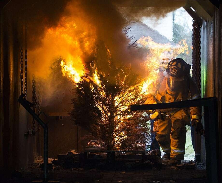 FILE PHOTO: The Houston Fire Department firefighters demonstrates how quickly and easily a Christmas tree can catch fire and burn at the HFD Training Academy on Tuesday, Dec. 10, 2019. Photo: Yi-Chin Lee, Staff Photographer