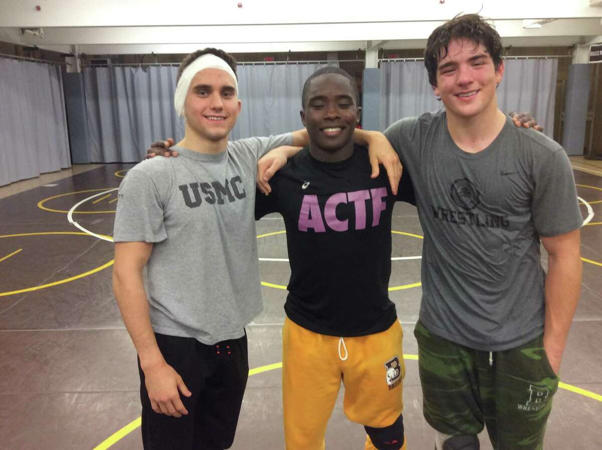 From left to right: Luca Errico, Nadji Ngbokoli and Clayton Ostrover are senior captains of the Brunswick School wrestling team.