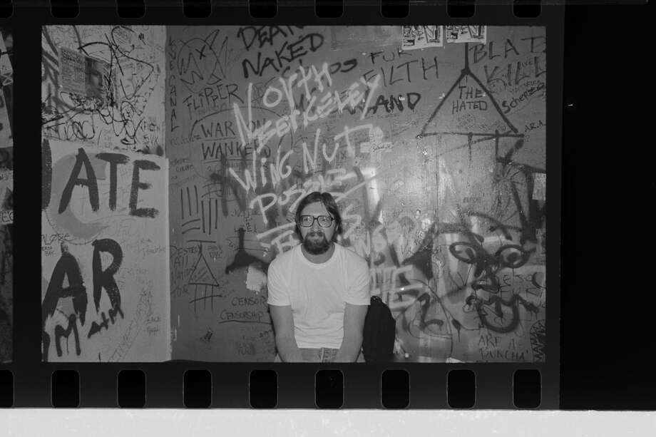 Murray Bowles is pictured at 924 Gilman in 1990. The iconic photographer captured a decades-long punk movement in the East Bay, Photo: Murray Bowles Archive