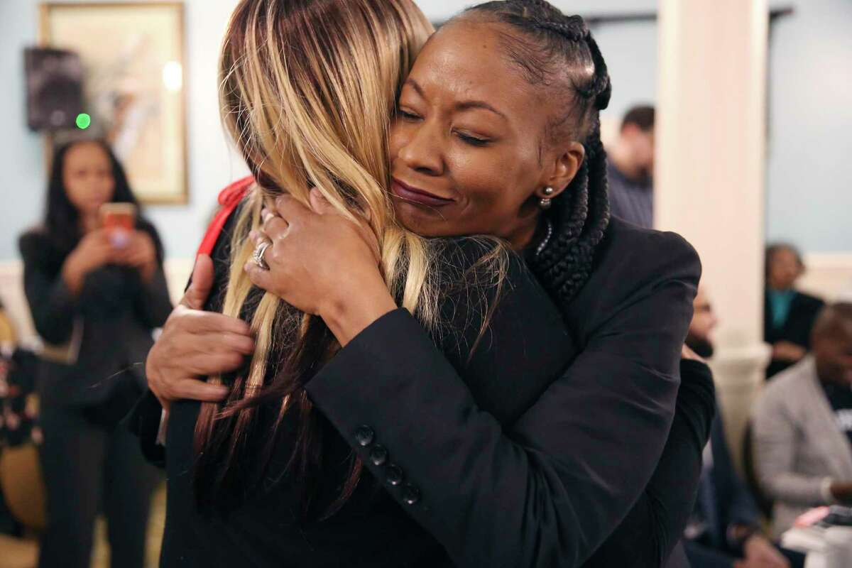 Dr. Lori Wilson, division chief of surgical oncology at Howard University, hugs a supporter after she addresses a training session for women of color at the Menger Hotel on Dec. 10, 2019. The session was hosted by the Tigerlily Foundation, a Virginia-based nonprofit that advocates on behalf of women with breast cancer and was aimed at women of color who face disparities in the diagnosis and treatment of metastatic breast cancer.
