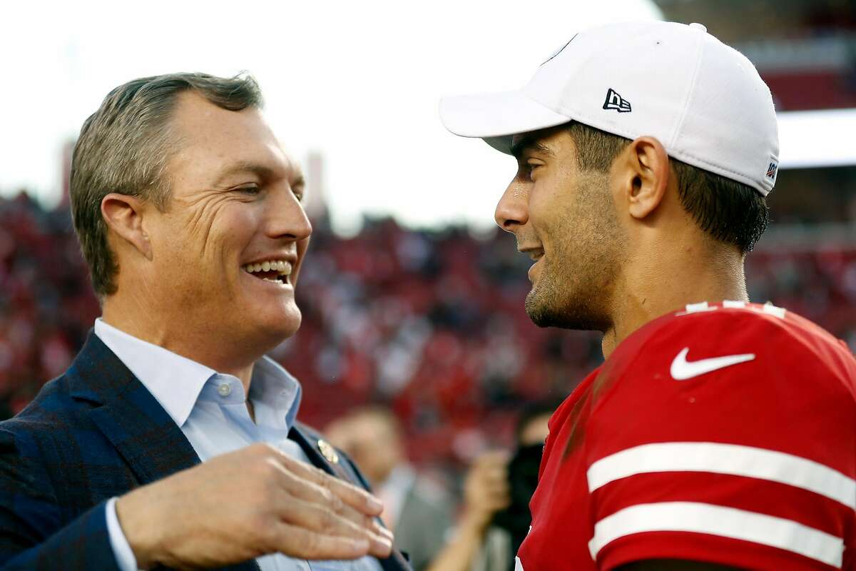 GM John Lynch and quarterback Jimmy Garoppolo after a 2019 win.