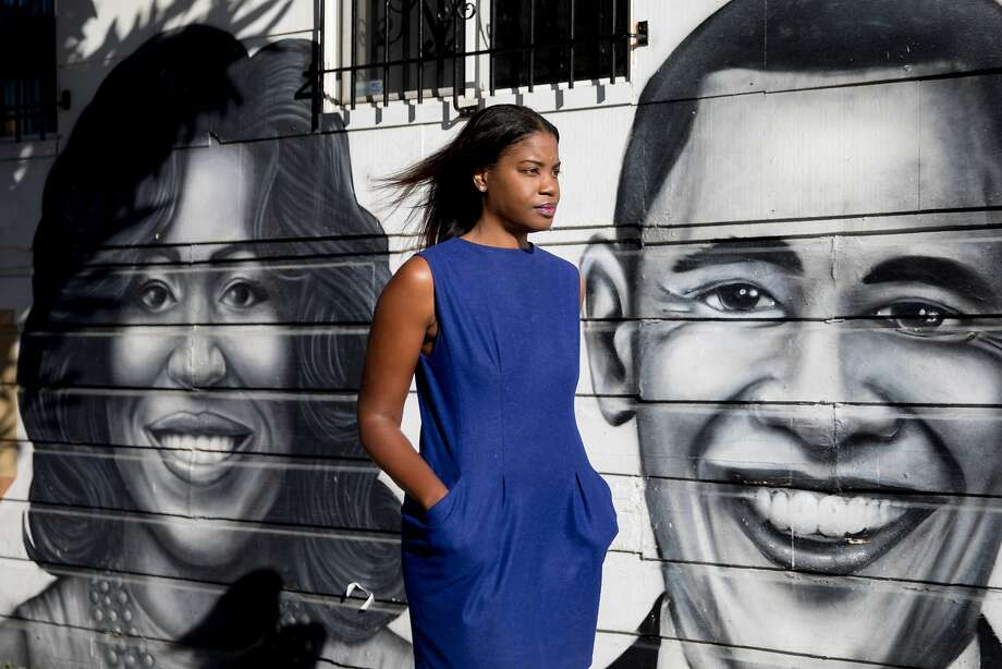 Tyra Fennell poses for a portrait next to a mural of Michelle and Barack Obama she curated on the corner of Oakdale Avenue and 3rd Street in the Bayview neighborhood of San Francisco, Calif. Friday, Dec. 6, 2019. Photo: Jessica Christian / The Chronicle
