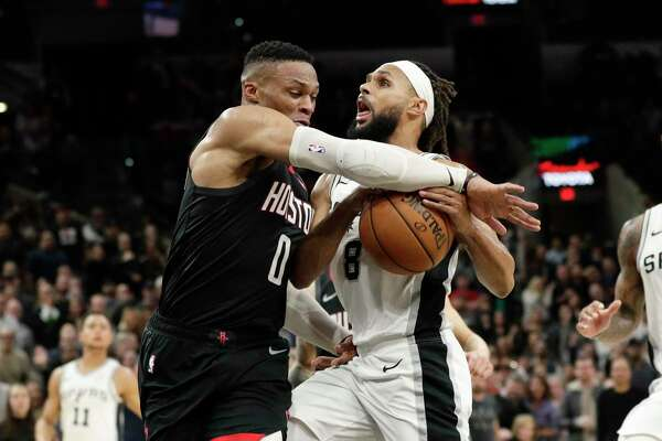 "Spurs guard Patty Mills, right, said he wasn't concerned about the Rockets protesting the Spurs' double-overtime win Dec. 3. ""We won it a few days ago, I thought,"" Mills said."