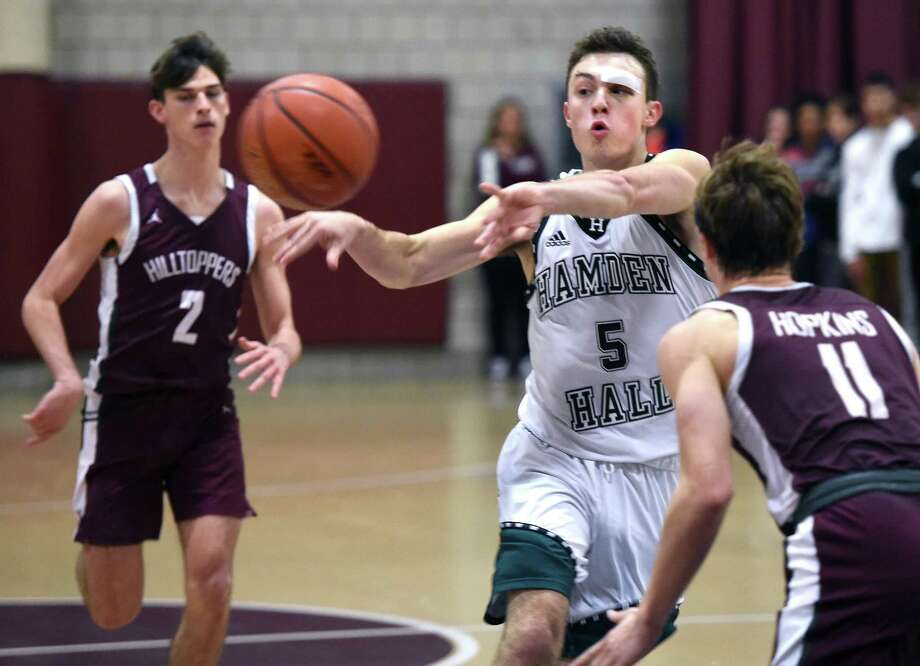 Jackson Benigni of Hamden Hall passes while driving against Hopkins at Hopkins on December 10, 2019. Photo: Arnold Gold / Hearst Connecticut Media / New Haven Register