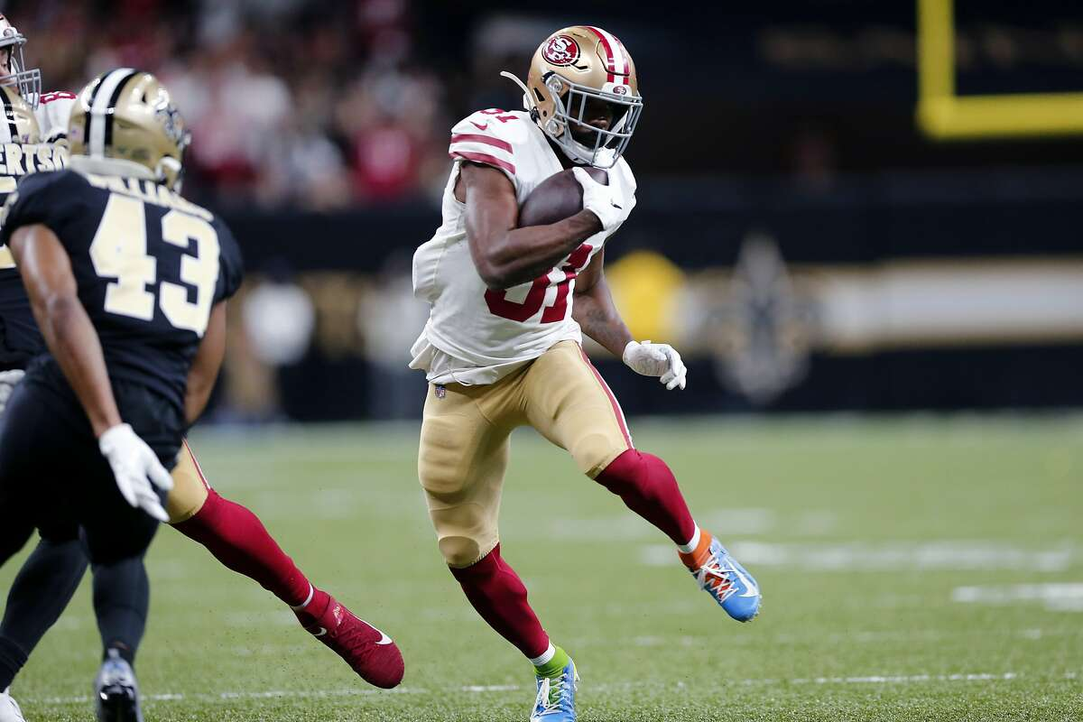 SSan Francisco 49ers running back Raheem Mostert (31) carries in the first half an NFL football game against the New Orleans Saints in New Orleans, Sunday, Dec. 8, 2019. (AP Photo/Brett Duke)