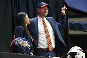 New UTSA head football coach, Jeff Traylor (right), is introduced by UTSA Vice President for Intercollegiate Athletics Lisa Campos (left) during a public announcement of Traylor's hiring at the Alamodome on Tuesday, Dec. 10, 2019. With introductions by UTSA President Dr. Taylor Eighmy and UTSA Vice President for Intercollegiate Athletics Lisa Campos, Traylor spoke with fervor about the path that led him to UTSA. With past and present players in the audience, Traylor also touched on his coaching philosophy and the steps he will take to help the Roadrunners succeed under his helm. Traylor is the third coach in the school's eighth year in collegiate football.