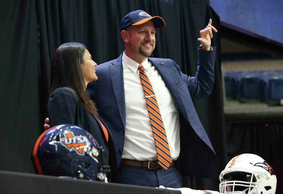 New UTSA head football coach, Jeff Traylor (right), is introduced by UTSA Vice President for Intercollegiate Athletics Lisa Campos (left) during a public announcement of Traylor's hiring at the Alamodome on Tuesday, Dec. 10, 2019. With introductions by UTSA President Dr. Taylor Eighmy and UTSA Vice President for Intercollegiate Athletics Lisa Campos, Traylor spoke with fervor about the path that led him to UTSA. With past and present players in the audience, Traylor also touched on his coaching philosophy and the steps he will take to help the Roadrunners succeed under his helm. Traylor is the third coach in the school's eighth year in collegiate football. Photo: Kin Man Hui, San Antonio Express-News / Staff Photographer / **MANDATORY CREDIT FOR PHOTOGRAPHER AND SAN ANTONIO EXPRESS-NEWS/NO SALES/MAGS OUT/ TV OUT