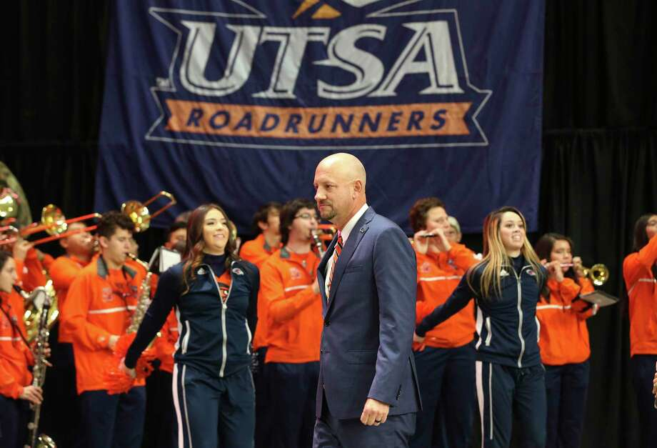 UTSA introduces its new head football coach, Jeff Traylor (center), in a public announcement at the Alamodome on Tuesday, Dec. 10, 2019. With introductions by UTSA President Dr. Taylor Eighmy and UTSA Vice President for Intercollegiate Athletics Lisa Campos, Traylor spoke with fervor about the path that led him to UTSA. With past and present players in the audience, Traylor also touched on his coaching philosophy and the steps he will take to help the Roadrunners succeed under his helm. Traylor is the third coach in the school's eighth year in collegiate football. Photo: Kin Man Hui, San Antonio Express-News / Staff Photographer / **MANDATORY CREDIT FOR PHOTOGRAPHER AND SAN ANTONIO EXPRESS-NEWS/NO SALES/MAGS OUT/ TV OUT