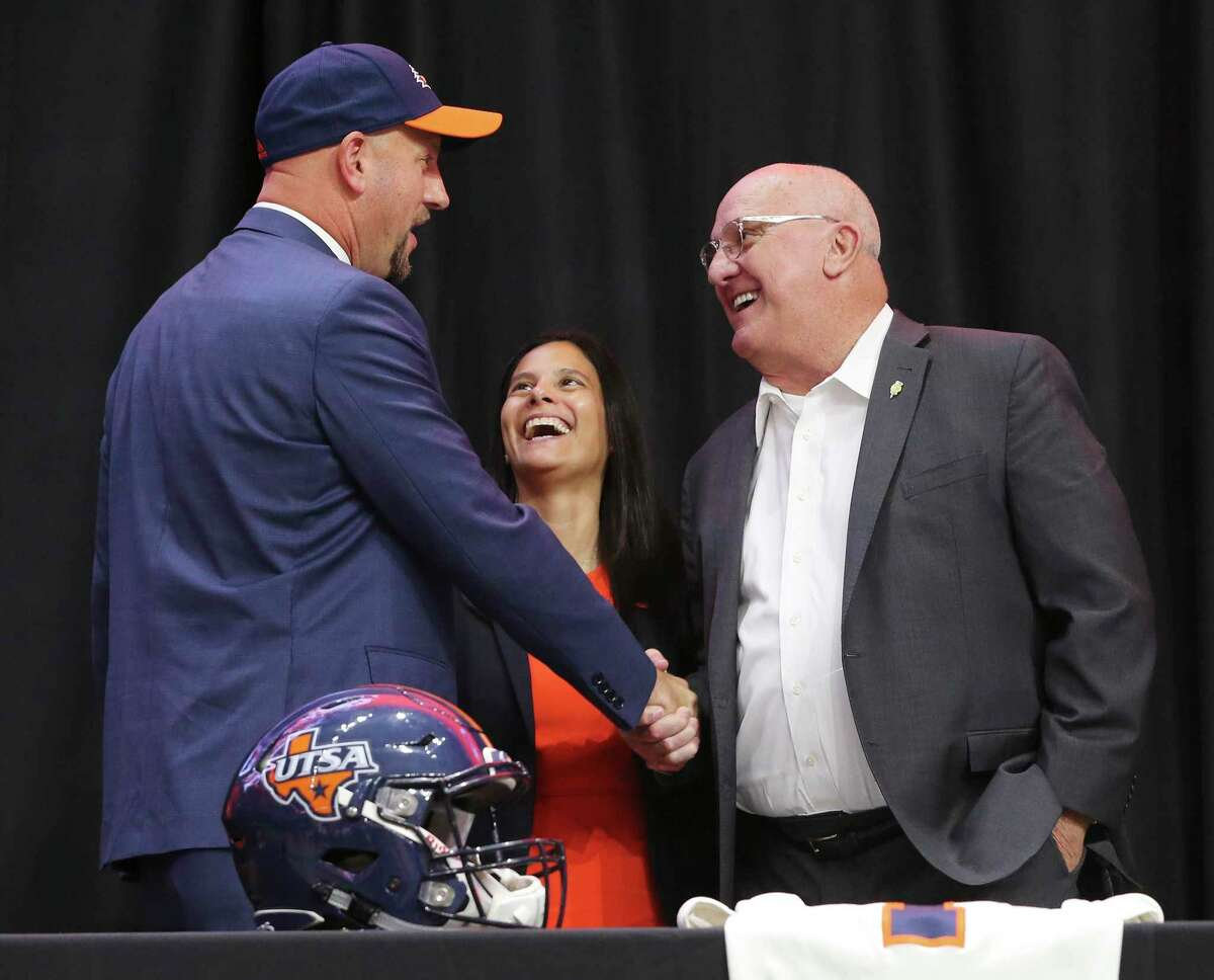 New UTSA head football coach, Jeff Traylor (from left), UTSA Vice President for Intercollegiate Athletics Lisa Campos and D.W. Rutledge, former Executive Director, Texas High School Coaches Association share a light moment after a public announcement of Traylor's hiring at the Alamodome on Tuesday, Dec. 10, 2019. With introductions by UTSA President Dr. Taylor Eighmy and UTSA Vice President for Intercollegiate Athletics Lisa Campos, Traylor spoke with fervor about the path that led him to UTSA. With past and present players in the audience, Traylor also touched on his coaching philosophy and the steps he will take to help the Roadrunners succeed under his helm. Traylor is the third coach in the school's eighth year in collegiate football.