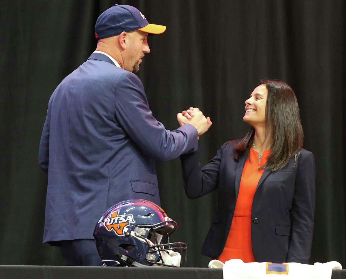 New UTSA head football coach, Jeff Traylor (left), shakes hands with UTSA Vice President for Intercollegiate Athletics Lisa Campos after a public announcement of Traylor's hiring at the Alamodome on Tuesday, Dec. 10, 2019. With introductions by UTSA President Dr. Taylor Eighmy and UTSA Vice President for Intercollegiate Athletics Lisa Campos, Traylor spoke with fervor about the path that led him to UTSA. With past and present players in the audience, Traylor also touched on his coaching philosophy and the steps he will take to help the Roadrunners succeed under his helm. Traylor is the third coach in the school's eighth year in collegiate football.