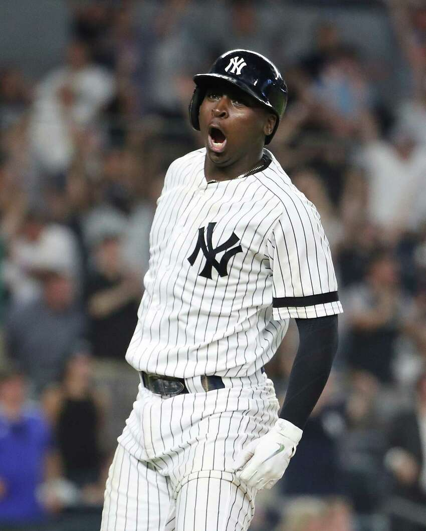 NEW YORK, NEW YORK - JULY 16: Didi Gregorius #18 of the New York Yankees reacts after hitting a grand slam in the eighth inning against the Tampa Bay Rays during their at Yankee Stadium on July 16, 2019 in New York City. (Photo by Al Bello/Getty Images)