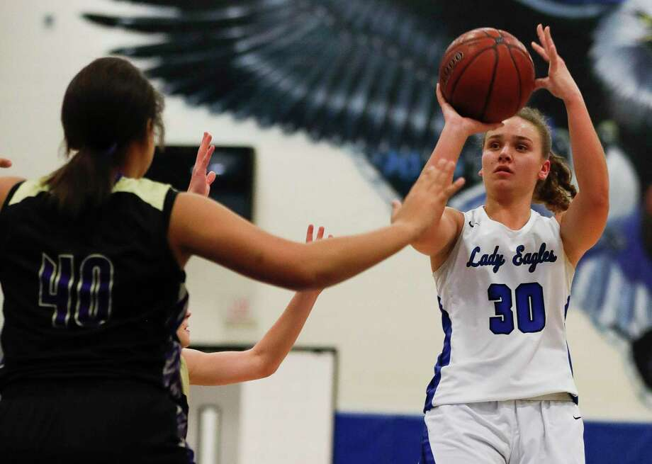 New Caney power forward Abigail Lynch (30) shoots a jump shot during the first quarter of a District 20-5A high school basketball game at New Caney High School, Tuesday, Dec. 10, 2019, in New Caney. Photo: Jason Fochtman, Houston Chronicle / Staff Photographer / Houston Chronicle