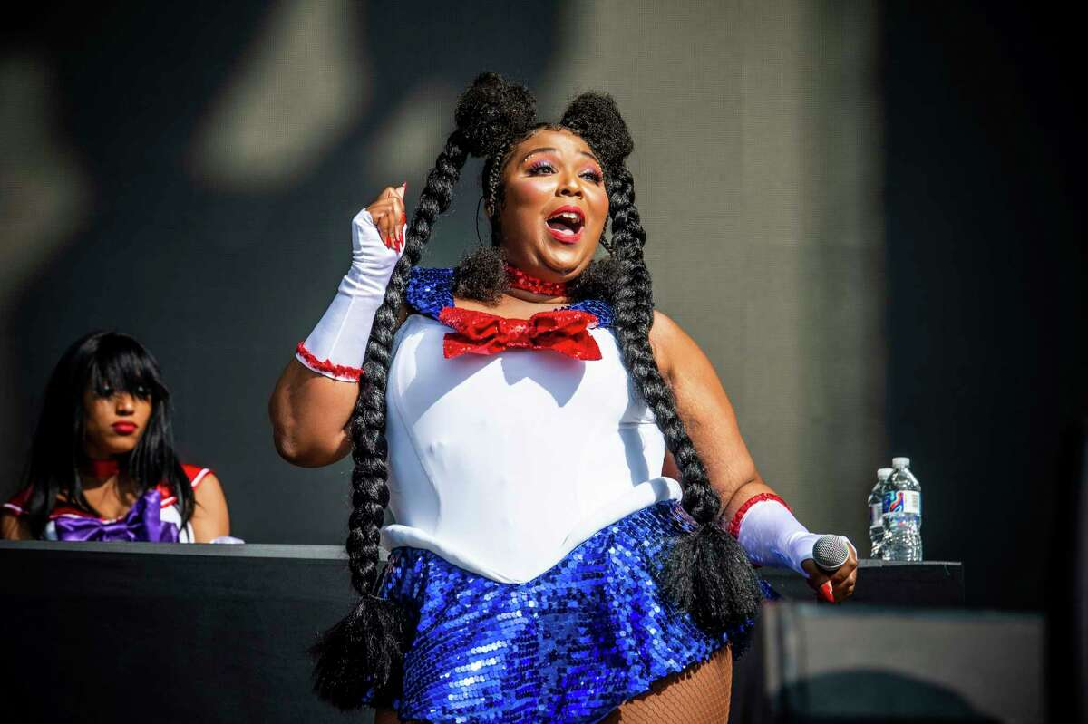 FILE - This Oct. 27, 2018 file photo shows Lizzo performing at the Voodoo Music Experience in New Orleans. The singer-rapper got up and twerked, revealing a cut out at the back of her short black T-shirt dress, and was shown on the stadium's huge television screens during Sunday night's Los Angeles Lakers game against the Minnesota Timberwolves. (Photo by Amy Harris/Invision/AP, File)
