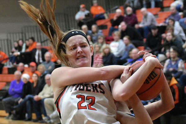 Edwardsville center Katelynne Roberts fights for a rebound with a Belleville East player during the first quarter Tuesday in Belleville.